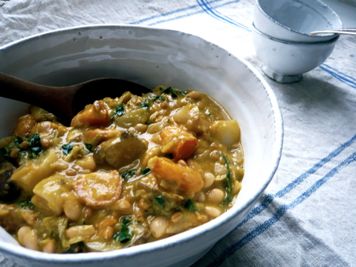 Fall vegetable cannellini bean stew with spelt berries and kale