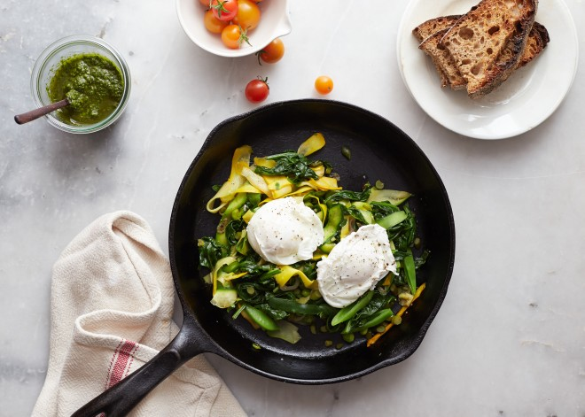 Zucchini tangle with poached eggs and green harissa