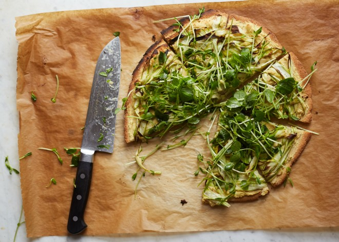 Chickpea pizza with asparagus and pea shoot tangle