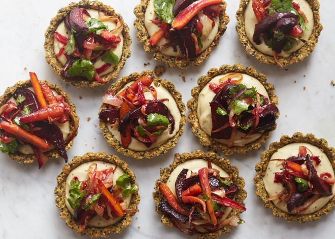 Roasted root vegetable tarts with spiced sesame crust